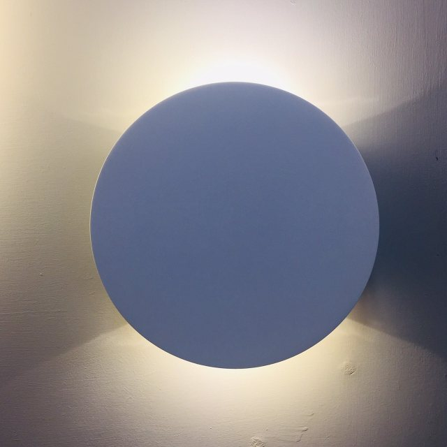 Small circular LED wall wash light