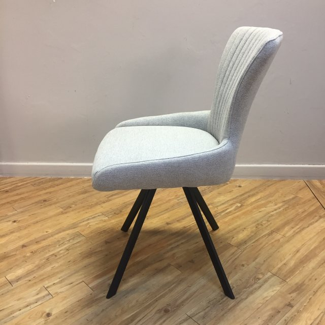 Grey dining chair with black legs
